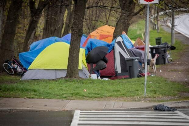 People experiencing homelessness camp in Toronto's east end on May 7, 2020. The city says it now has enough room to house those living in encampments in the following four sites: Moss Park, Alexandra Park, Trinity Bellwoods and Lamport Stadium. (Evan Mitsui/CBC - image credit)
