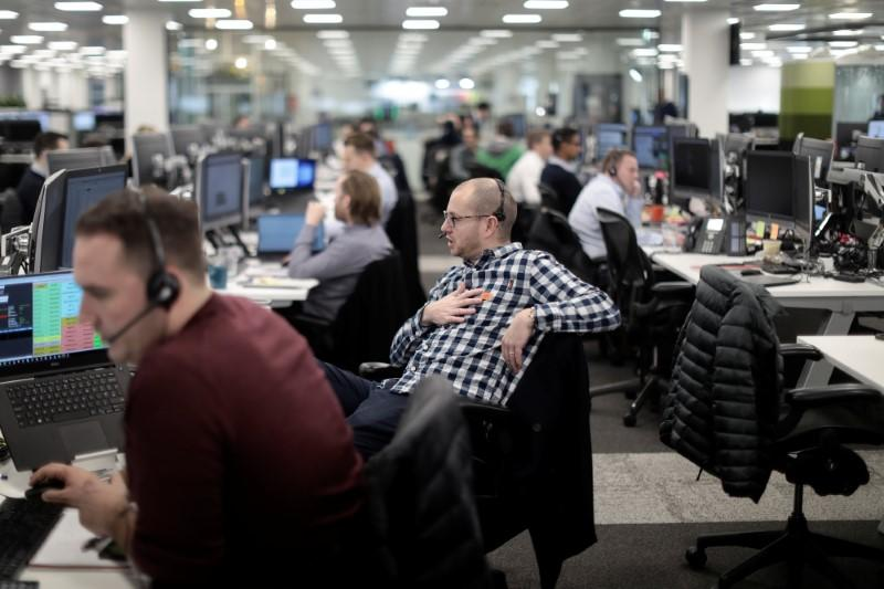 Brokers work on the trading floor at IG Index in London