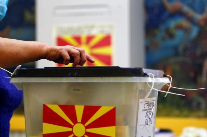 A person casts his ballot at a polling station during the general election, in Strumica