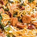 """<p>This meaty <a href=""""https://www.delish.com/uk/cooking/recipes/a28841234/three-ingredient-spaghetti-recipe/"""" rel=""""nofollow noopener"""" target=""""_blank"""" data-ylk=""""slk:spaghetti"""" class=""""link rapid-noclick-resp"""">spaghetti</a> in a cream sauce is the whole package for an easy dinner.</p><p>Get the <a href=""""https://www.delish.com/uk/cooking/recipes/a31656606/spaghetti-with-sun-dried-tomatoes-sausage-and-spinach-recipe/"""" rel=""""nofollow noopener"""" target=""""_blank"""" data-ylk=""""slk:Spaghetti with Sun-Dried Tomatoes, Sausage, and Spinach"""" class=""""link rapid-noclick-resp"""">Spaghetti with Sun-Dried Tomatoes, Sausage, and Spinach</a> recipe.</p>"""