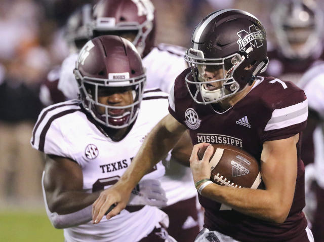 Mississippi State quarterback Nick Fitzgerald (7) rushes for additional yards as Texas A&M linebacker Tyrel Dodson (25) pursues during the first half of an NCAA college football game Saturday, Oct. 27, 2018, in Starkville, Miss. (AP Photo/Jim Lytle)
