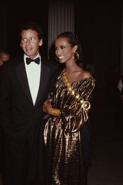 <p>Fashion designer Calvin Klein arrives at the Costume Institute Gala with supermodel Iman on his arm in 1981. The model, who emerged on the scene in the mid-'70s, was a muse for the designer. </p>