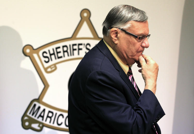 FILE -- In this April 3, 2012, file photo, Maricopa County Sheriff Joe Arpaio pauses during a press conference in Phoenix. The tough-talking sheriff, still facing a federal lawsuit alleging his department violates Hispanics' civil rights, is the last man standing of the three Phoenix politicians who made Arizona a leader in the crackdown against illegal immigration. (AP Photo/Ross D. Franklin, File)
