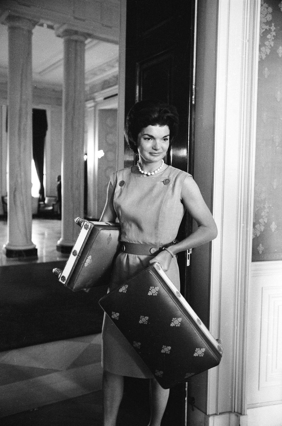 "<p>Shortly after moving into the White House, Jackie embarked on a <a href=""https://www.jfklibrary.org/learn/about-jfk/jfk-in-history/the-white-house-restoration"" rel=""nofollow noopener"" target=""_blank"" data-ylk=""slk:complete restoration"" class=""link rapid-noclick-resp"">complete restoration</a> of the historic residence. Here, during a meeting of the White House restoration project, Jackie moves two antique footstools dating all the way back to the Teddy Roosevelt presidency. </p>"