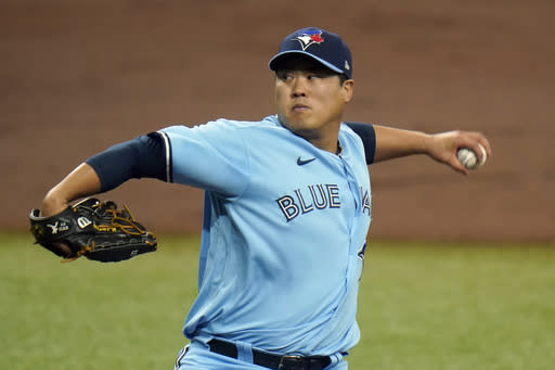 Toronto Blue Jays' Hyun-Jin Ryu pitches to the Tampa Bay Rays during the first inning of Game 2 of an American League wild-card baseball series Wednesday, Sept. 30, 2020, in St. Petersburg, Fla. (AP Photo/Chris O'Meara)