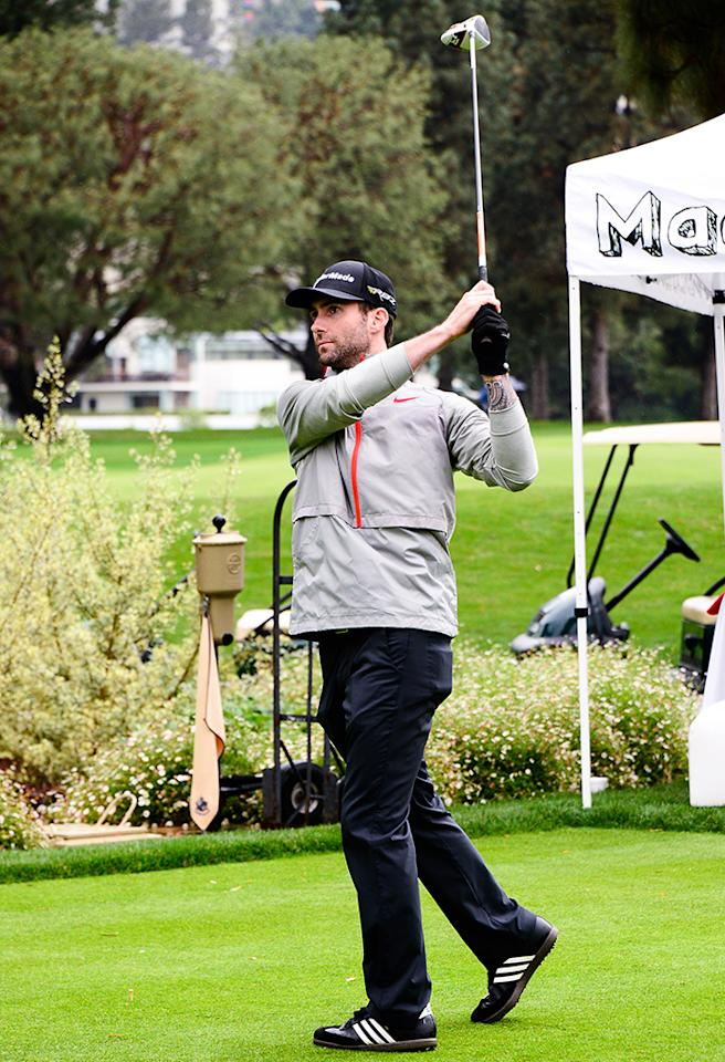 He's hot, he's a stellar musican, and a good golfer. What more could a gal want? Adam Levine hit the links at Monday's 6th Annual George Lopez Celebrity Golf Classic to benefit the Lopez Foundation. Scott Foley, Benjamin Bratt, and Don Cheadle also took part in the tournament. (5/6/2013)