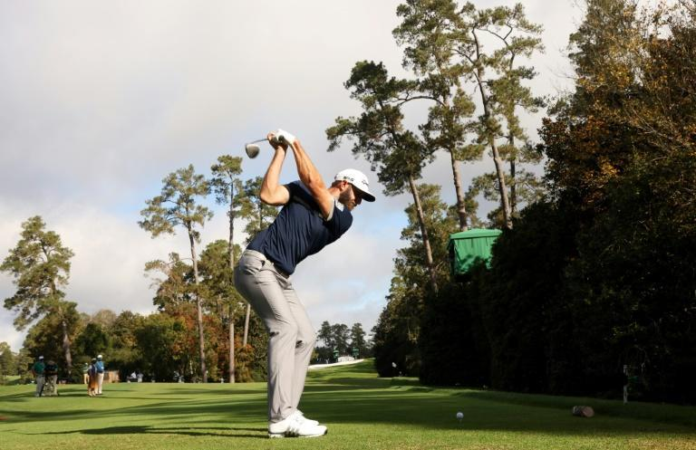 World number one Dustin Johnson birdied the 18th hole Friday to grab a share of the lead after the storm-hit opening round of the 84th Masters