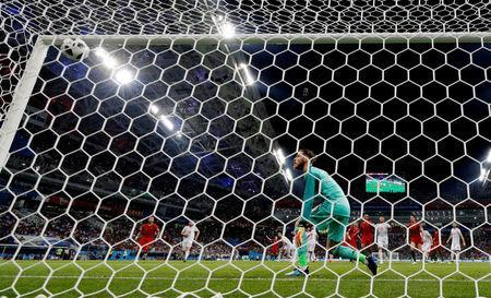 FILE PHOTO: Fisht Stadium, Sochi, Russia - June 15, 2018 Spain's David de Gea looks on as Portugal's Cristiano Ronaldo scores their third goal from a free kick to complete his hat-trick REUTERS/Ueslei Marcelino/File Photo