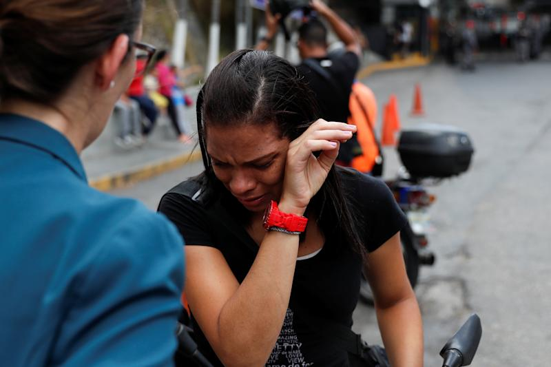 A relative of an inmate cries outside a detention center of the Bolivarian National Intelligence Service (SEBIN), where a riot occurred, according to relatives, in Caracas