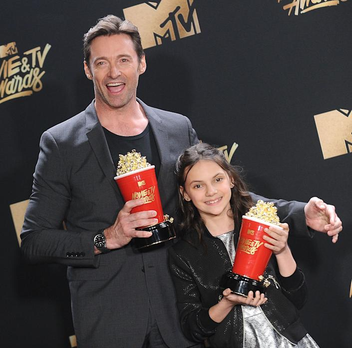 Hugh Jackman and Dafne Keen poses in the press room at the 2017 MTV Movie and TV Awards at The Shrine Auditorium on May 7, 2017 in Los Angeles, California.
