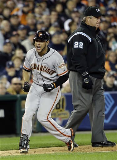 San Francisco Giants' Gregor Blanco reacts after hitting a run-scoring triple during the second inning of Game 3 of baseball's World Series against the Detroit Tigers Saturday, Oct. 27, 2012, in Detroit. (AP Photo/David J. Phillip)
