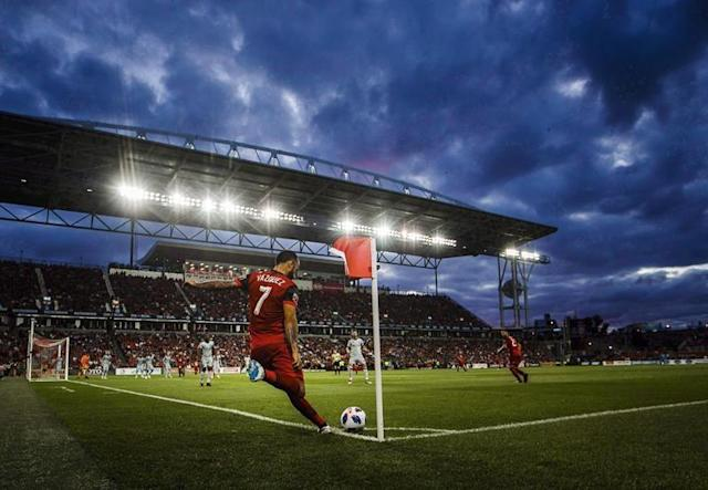 """TORONTO — Like an electronic caterpillar, a special machine is inching its way across the BMO Field pitch these days. It's going 24 hours a day stitching green artificial fibres into the natural grass.Imagine a sewing machine the size of a Winnebago. Housed inside a tarpaulin cover — the eight Europeans staffing the machine find it cold in Canada — giant needles grab the polyethylene fibres and stuff them into the ground every 20 millimetres. The made-in-Abu-Dhabi fibres are 20 centimetres long and stitched 18 centimetres deep into the ground.Each piece is actually six strands. Pull them apart and tie them together and the fibres being stitched into the stadium by Lake Ontario would span the globe 1.2 times.Robert Heggie, director of grounds for Toronto FC, delivers the statistic with a hearty laugh.Thursday was Day 3 with five or six more to go. Heggie says the enhanced pitch will be ready for April 19 when Minnesota United comes to visit.In the meantime the crews from SISGrass, based out of the Netherlands, are working around the clock installing what Heggie calls """"Rebar for the soil.""""It will take 22 pallets, each weighing 448 kilograms and carrying 64 rolls of the artificial fibre.When it's all done, about five per cent of the surface will be artificial with the roots of the real grass attaching to the fibres. And BMO Field will join Green Bay's Lambeau Field — the only other stadium in North American with SISGrass — and London's Wembley Stadium among others with a hybrid surface.""""The investment on this square of grass has been phenomenal,"""" said Heggie. """"There's very few groundskeepers around the world that get the support that I get.""""Not to mention feedback. Before every game, Toronto FC captain Michael Bradley inspects the pitch. And he's not someone you want mad at you.For Heggie, the new hybrid grass should deliver a firmer, truer, more consistent playing surface — something Toronto FC players have been clamouring for. The big bodies in the CFL trenches shoul"""