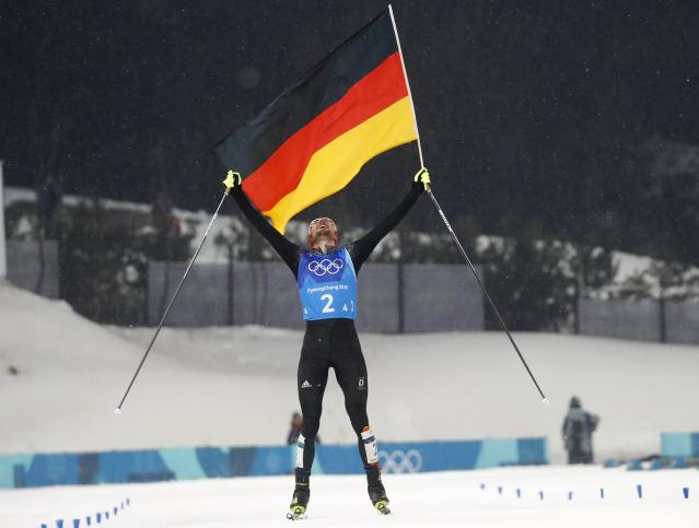 Nordic Combined Events - Pyeongchang 2018 Winter Olympics - Men's Team 4 x 5 km Final - Alpensia Cross-Country Skiing Centre - Pyeongchang, South Korea - February 22, 2018 - Johannes Rydzek of Germany celebrates with the German flag as he crosses the finish line. REUTERS/Kai Pfaffenbach