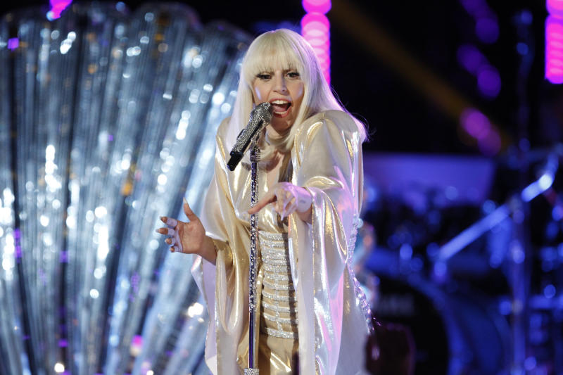 """FILE - In this photo provided by NBC Lady Gaga performs during the season five finale of """"The Voice"""" on Tuesday, Dec. 17, 2013, in Los Angeles. NBC announced Monday, Feb. 10, 2014, that Will Smith will appear on the Feb. 17 debut of """"The Tonight Show Starring Jimmy Fallon."""" U2 will perform. Justin Timberlake will close out the week, which will also include appearances from Michelle Obama, Will Ferrell, Bradley Cooper, Kristen Wiig and Jerry Seinfeld. Lady Gaga, Arcade Fire and Tim McGraw will also perform during the week. (AP Photo/NBC, Trae Patton)"""