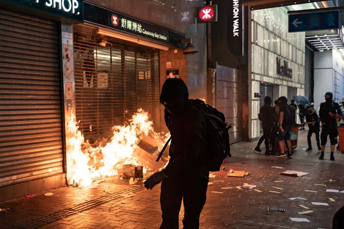 Pro-democracy protesters set a fire at the entrance of a subway station in Hong Kong on Oct. 4, 2019.   Anthony Kwan—Getty Images