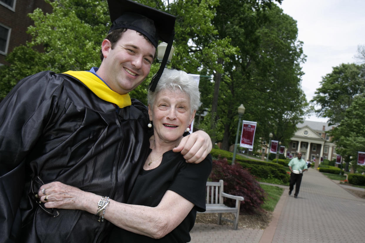 A grandmother hugs her grandson on his graduation day at Roanoke College. (Photo credit: Jeffrey Greenberg/Universal Images Group via Getty Images)