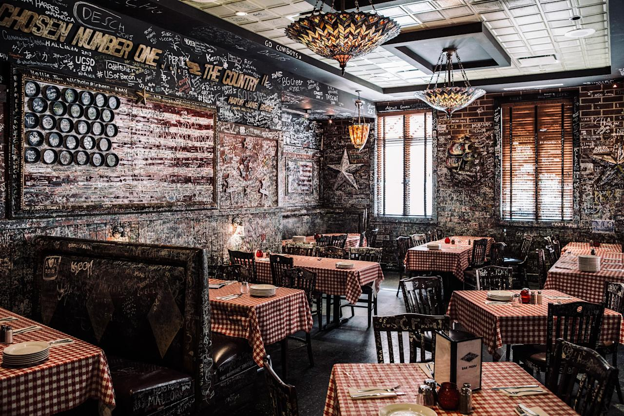 <p><strong>Tell us about your first impressions when you arrived.</strong><br> The original Gino's, open since 1966, is covered in customer's signatures, Blues Brothers paraphernalia, red-checkered tablecloths, and scenes of Chicago. It's darkly lit, comfy, and welcoming.</p> <p><strong>What was the crowd like?</strong><br> You won't find too many locals at the original Gino's East—its proximity to the Mag Mile attracts many of the area's tourists, who come clamoring for the pizzeria's iconic pies.</p> <p><strong>What should we be drinking?</strong><br> Gino's brews its own beer at the nearby (and newer) Brew Pub in River North. Available by the pint or pitcher, check out the La Salle Street Lager, a fresh German helles-style brew, or the Pineapple Imposter, an American Pale Ale.</p> <p><strong>Main event: the food. Give us the lowdown—especially what not to miss.</strong><br> Gino's differentiates itself from other deep dish pizzas in both crust and topping. The crunchy crust, long rumored to contain cornmeal, does feature corn oil, resulting in sweet, savory flavors and a crumbly, crunchy exterior that is soft on the inside. Gino's noteworthy spin on deep dish is the disc of sausage—yes, you read that right—layered just below the sauce. The fennel-tinged meat ensures the crust doesn't get soggy and the cheese doesn't melt—bonus points for having sausage in every bite.</p> <p><strong>And how did the front-of-house folks treat you?</strong><br> Staff is efficient, but they have to be. The long waits from tourists at the downtown location keeps the place so busy, Gino's is basically operating on automatic at this point.</p> <p><strong>What's the real-real on why we're coming here?</strong><br> For a unique take on deep dish, with sausage in every bite, at a Chicago stalwart, head to Gino's East.</p>