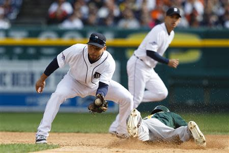 Oct 7, 2013; Detroit, MI, USA; Oakland Athletics center fielder Coco Crisp (4, right) steals second base against Detroit Tigers second baseman Omar Infante (4) in the third inning in game three of the American League divisional series playoff baseball game at Comerica Park. Rick Osentoski-USA TODAY Sports
