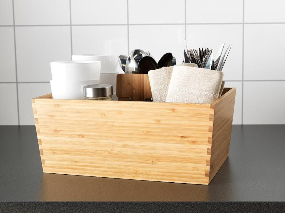 "<p>This decorative <a href=""https://www.popsugar.com/buy/Variera%20Box%20With%20Handle-446963?p_name=Variera%20Box%20With%20Handle&retailer=ikea.com&price=20&evar1=casa%3Aus&evar9=46151613&evar98=https%3A%2F%2Fwww.popsugar.com%2Fhome%2Fphoto-gallery%2F46151613%2Fimage%2F46152146%2FVariera-Box-Handle&list1=shopping%2Cikea%2Corganization%2Ckitchens%2Chome%20shopping&prop13=api&pdata=1"" rel=""nofollow noopener"" target=""_blank"" data-ylk=""slk:Variera Box With Handle"" class=""link rapid-noclick-resp"">Variera Box With Handle</a> ($20) can be used to keep utensils, spices, napkins, and everything in the middle. Place it inside your pantry or leave it on the counter for easy access.</p>"