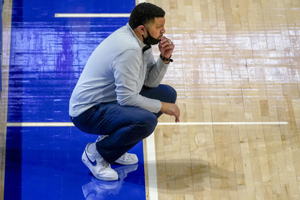 Pittsburgh head coach Jeff Capel watches as his team plays against Syracuse during the first half of an NCAA college basketball game, Saturday, Jan. 16, 2021, in Pittsburgh. Pittsburgh won 96-76. (AP Photo/Keith Srakocic)
