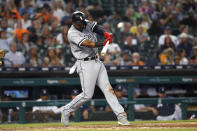 Chicago White Sox's Eloy Jimenez hits a grand slam during the fourth inning of the team's baseball game against the Detroit Tigers in Detroit, Friday, Sept. 20, 2019. (AP Photo/Paul Sancya)