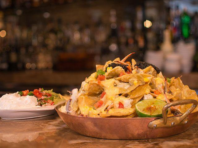 "<p>The nachos at <a href=""https://www.tripadvisor.com/Restaurant_Review-g56003-d442217-Reviews-Brennan_s_of_Houston-Houston_Texas.html"" rel=""nofollow noopener"" target=""_blank"" data-ylk=""slk:Brennan's"" class=""link rapid-noclick-resp"">Brennan's</a> are not your average sports bar nachos. These bad boys are loaded up with a pound Louisiana crab meat, roasted corn, Saint Andre queso, avocado, pico de gallo and lime crema, and Petrossian caviar. </p>"