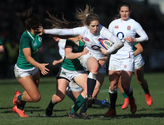 England wing Abby Dow attempts to escape the attentions Ireland pair Sene Naoupu and Clair Keohane during the Women's Six Nations. Dow was one of five English try-scorers during a resounding 27-0 success in February at Castle Park, Doncaster. England eventually went on to complete a tournament Grand Slam after completing their fixtures in November following postponements caused by Covid-19