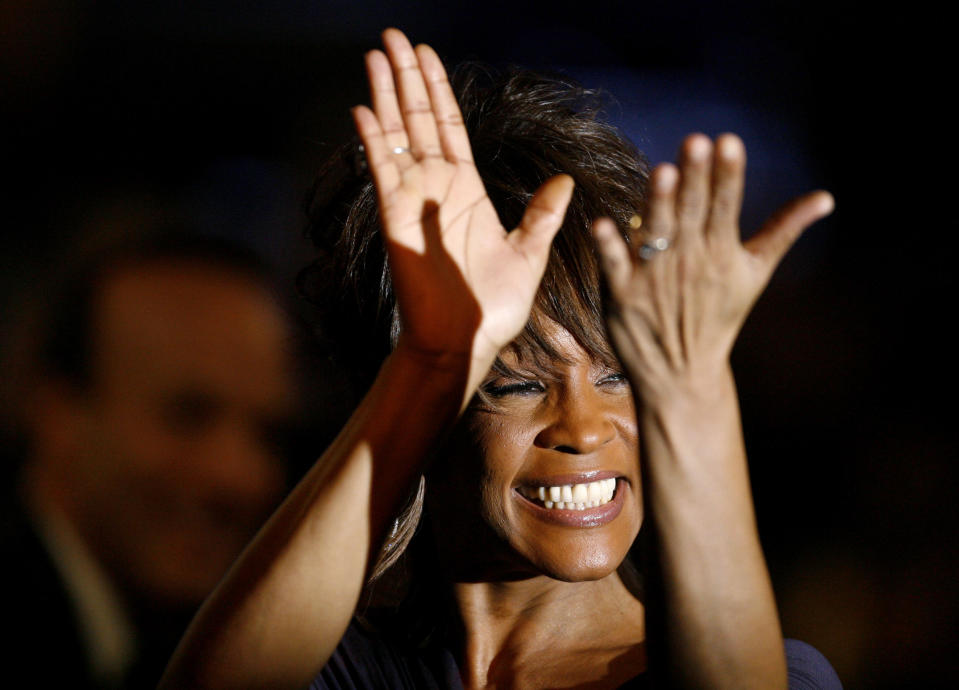 Singer Whitney Houston gestures at the Clive Davis pre-Grammy party in Beverly Hills, California February 9, 2008. The Grammy awards will be given out in Los Angeles on February 10.  REUTERS/Mario Anzuoni   (UNITED STATES)