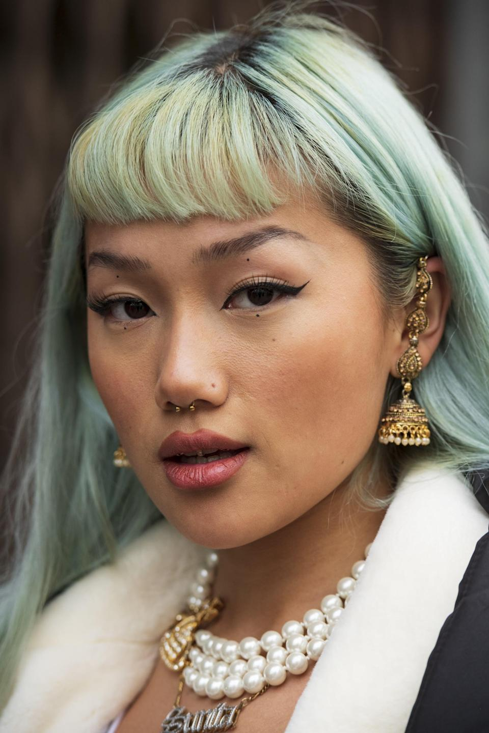 <p>As an Aries, you're not afraid to make a big hair change. You know what you want and you're not afraid to make it happen. That's why a bold choice like blunt, straight-across bangs is great. </p>