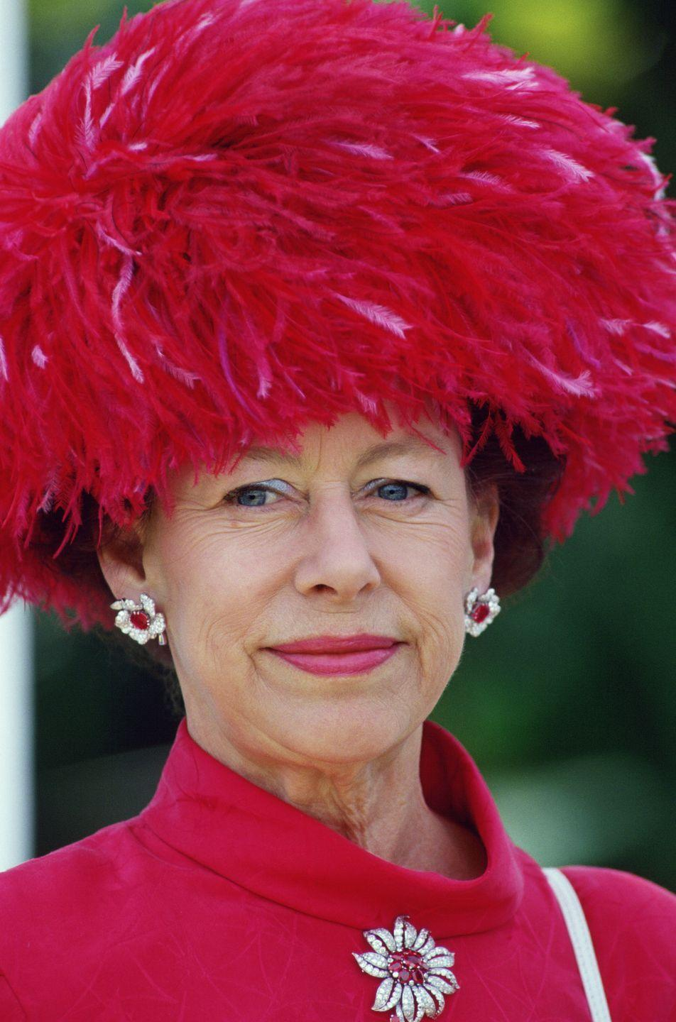 <p>Queen Elizabeth isn't the only royal who could do monochrome—her sister, Princess Margaret was equally deft as she showed with this eye-catching look in which she paired a pink feathered hat, with matching suit, earrings, brooch, and lipstick.</p>
