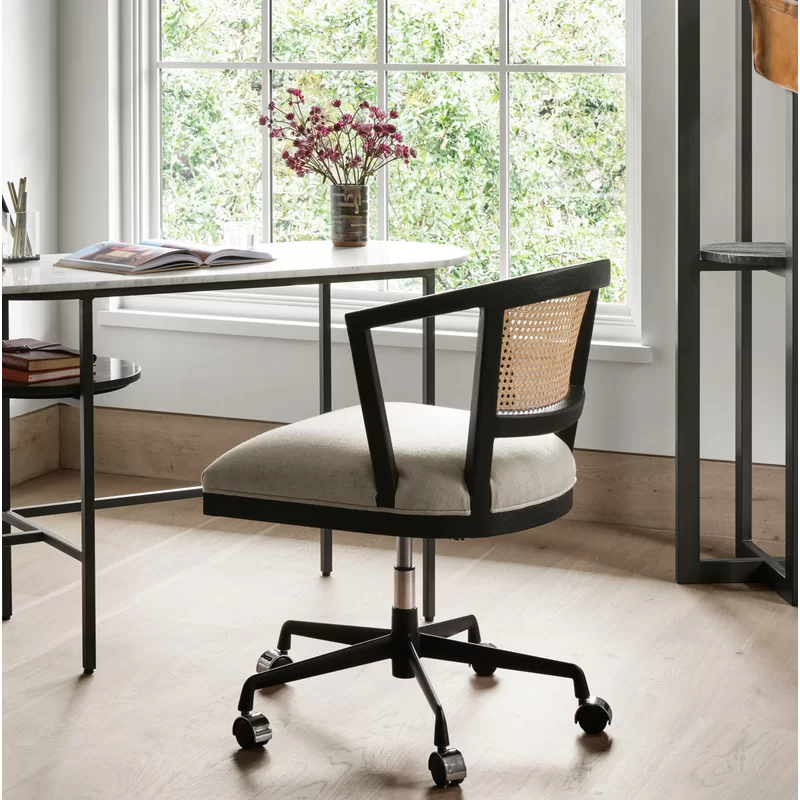 """<h2>Joss & Main Euben Task Chair</h2><br><strong>Best For: Mixed Material</strong> <strong>Texture</strong><br>This showstopping chair has got it all: an on-trend look, ergonomic design, a brushed wood frame with natural cane inlay, a linen upholstered seat, and a swivel base.<br><br><strong>The Hype: </strong>5 out of 5 stars and 3 reviews on <a href=""""https://www.jossandmain.com/furniture/pdp/euben-task-chair-j000217621.html"""" rel=""""nofollow noopener"""" target=""""_blank"""" data-ylk=""""slk:Joss & Main"""" class=""""link rapid-noclick-resp"""">Joss & Main</a><br><br><strong>Comfy Butts Say:</strong> """"It's even better in person and great quality!""""<br><br><strong>Joss & Main</strong> Euben Task Chair, $, available at <a href=""""https://go.skimresources.com/?id=30283X879131&url=https%3A%2F%2Fwww.jossandmain.com%2Ffurniture%2Fpdp%2Feuben-task-chair-j000217621.html"""" rel=""""nofollow noopener"""" target=""""_blank"""" data-ylk=""""slk:Joss & Main"""" class=""""link rapid-noclick-resp"""">Joss & Main</a>"""