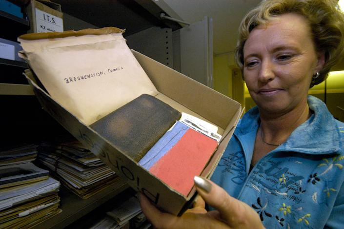 Gabriele Wilke employee of the archive holds a box of the prisoners personal belongings from Neuengamme Concentration Camp near Hamburg at the International Tracing Service in Bad Arolsen, Germany, Friday, Oct. 27, 2006. (AP Photo/Bernd Kammerer)