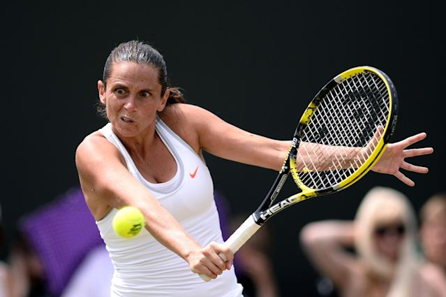 LONDON, ENGLAND - JULY 01: Roberta Vinci of Italy plays a backhand during her Ladies' Singles fourth round match against Na Li of China on day seven of the Wimbledon Lawn Tennis Championships at the All England Lawn Tennis and Croquet Club on July 1, 2013 in London, England. (Photo by Dennis Grombkowski/Getty Images)