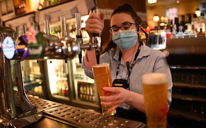 Pubs, restaurants, cafés and bars will be able to open indoors in step three of lockdown easing - OLI SCARFF / AFP