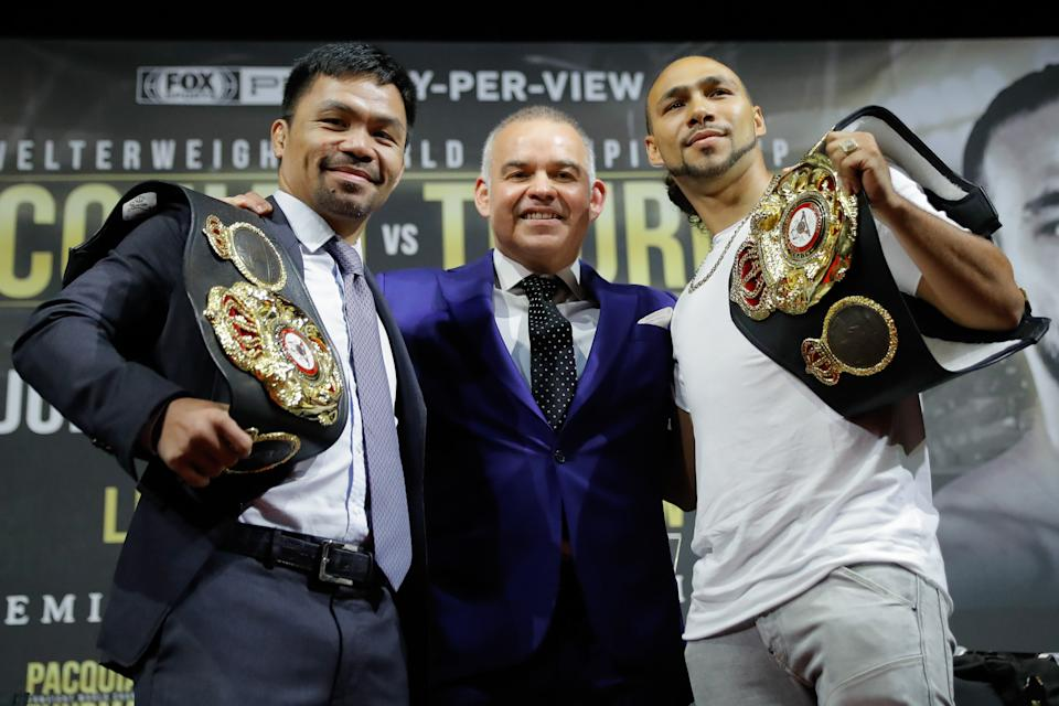 NEW YORK, NEW YORK - MAY 21: (L-R) Manny Pacquiao, WBA president Gilberto Mendoza and Keith Thurman pose for the media during a press conference at Gotham Hall in preparation for their upcoming fight on May 21, 2019 in New York City. Pacquiao and Thurman will meet for the world welterweight championship title on July 20, in Las Vegas, Nevada.  (Photo by J. Yim/Getty Images)