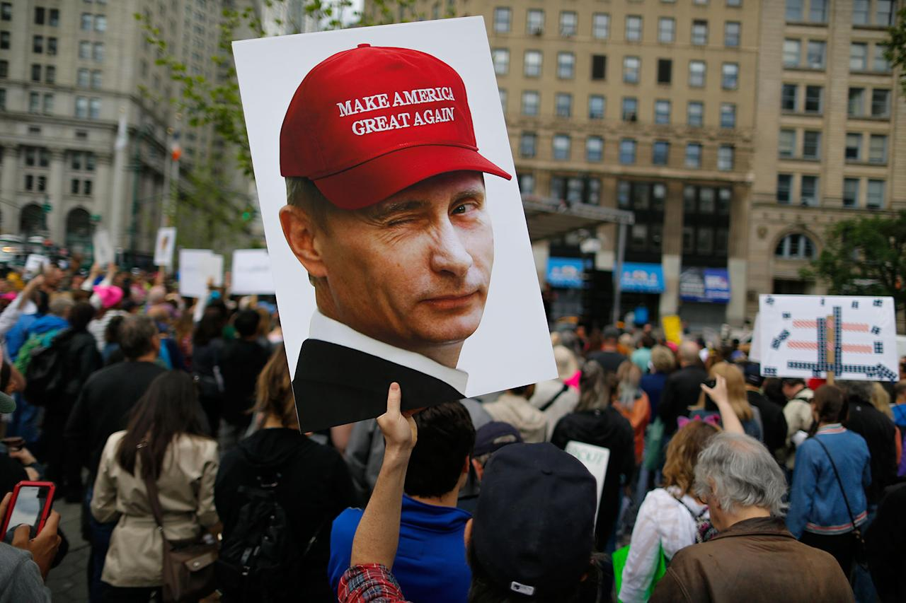 "<p>A demonstrator holds up a sign of Vladimir Putin during an anti-Trump ""March for Truth"" rally on June 3, 2017 in New York City. (Photo: Eduardo Munoz Alvarez/Getty Images) </p>"