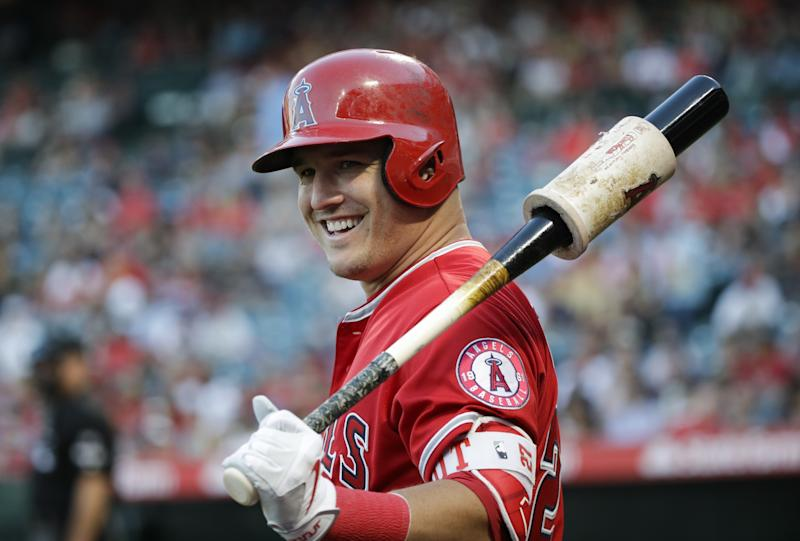 Los Angeles Angels' Mike Trout smiles while getting ready to bat during the first inning of the team's baseball game against the Tampa Bay Rays, Friday, July 14, 2017, in Anaheim, Calif.