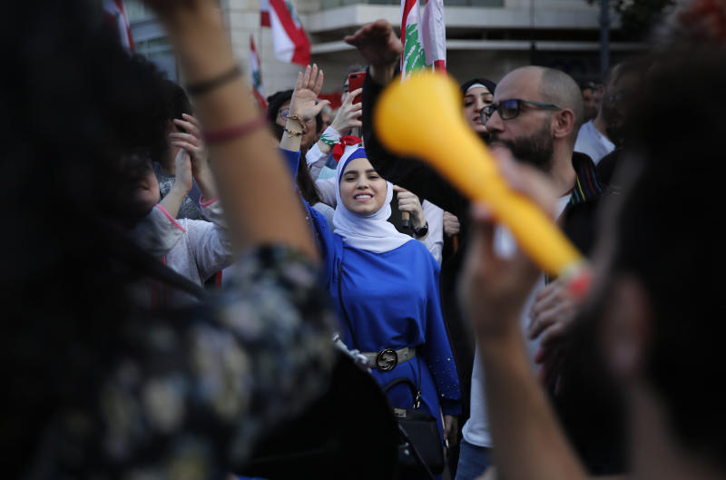 Lebanese protesters shout slogans as they march in Beirut, Lebanon, Sunday, Dec. 1, 2019. Protesters have been holding demonstrations since Oct. 17 demanding an end to widespread corruption and mismanagement by the political class that has ruled the country for three decades. (AP Photo/Hussein Malla)