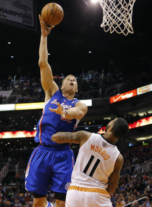 Los Angeles Clippers forward Blake Griffin (32) shoots over Phoenix Suns forward Markieff Morris (11) during the first half of an NBA basketball game, Wednesday, April 2, 2014, in Phoenix. (AP Photo/Matt York)