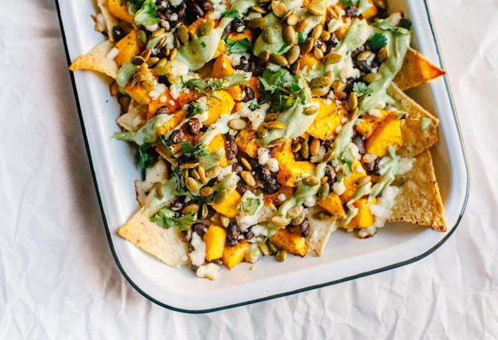 """<p>Savory roasted pumpkin meets all your favorite nacho toppings—it's the ultimate game day dish. </p><p><strong>Get the recipe at <a href=""""https://www.brewinghappiness.com/loaded-vegetarian-pumpkin-nachos/"""" rel=""""nofollow noopener"""" target=""""_blank"""" data-ylk=""""slk:Brewing Happiness"""" class=""""link rapid-noclick-resp"""">Brewing Happiness</a>. </strong></p><p><a class=""""link rapid-noclick-resp"""" href=""""https://go.redirectingat.com?id=74968X1596630&url=https%3A%2F%2Fwww.walmart.com%2Fsearch%3Fq%3Dpioneer%2Bwoman%2Bplatters&sref=https%3A%2F%2Fwww.thepioneerwoman.com%2Ffood-cooking%2Fmeals-menus%2Fg36729946%2Fsavory-pumpkin-recipes%2F"""" rel=""""nofollow noopener"""" target=""""_blank"""" data-ylk=""""slk:SHOP PLATTERS"""">SHOP PLATTERS</a></p>"""