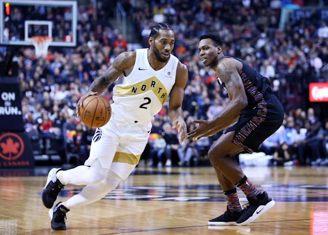 TORONTO, ON - JANUARY 11: Kawhi Leonard #2 of the Toronto Raptors dribbles the ball as Treveon Graham #21 of the Brooklyn Nets defends during the first half of an NBA game at Scotiabank Arena on January 11, 2019 in Toronto, Canada. (Photo by Vaughn Ridley/Getty Images)