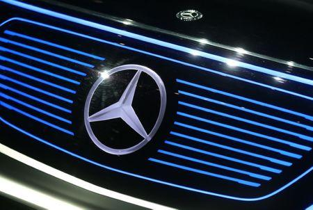A Mercedes sign is seen on the car before the Daimler annual shareholder meeting in Berlin, Germany, March 29, 2017. REUTERS/Hannibal Hanschke