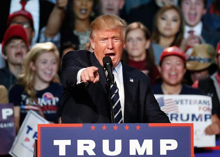 <p>Republican presidential candidate Donald Trump speaks at a campaign rally in Grand Rapids, Mich., Tuesday, Nov. 8, 2016. (Photo: Paul Sancya/AP) </p>