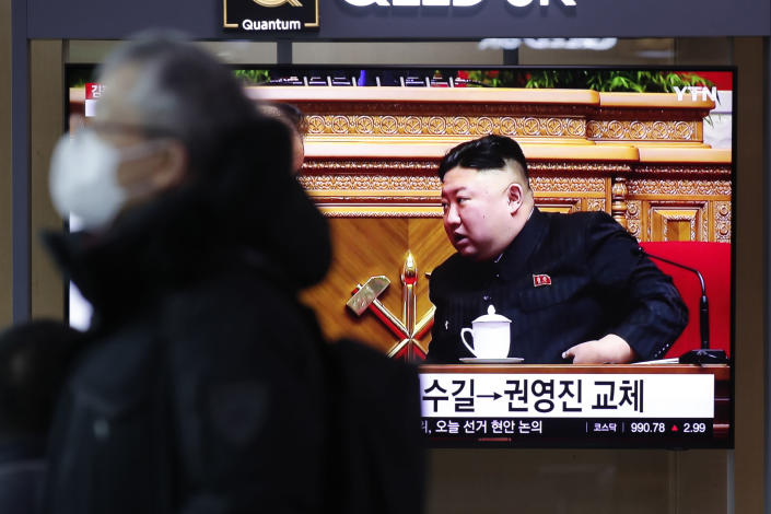 """A man wearing a face mask walks past near a TV screen showing a footage of North Korean leader Kim Jong Un, at the Seoul Railway Station in Seoul, South Korea, Monday, Jan. 11, 2021. Kim was given a new title, """"general secretary"""" of the ruling Workers' Party, formerly held by his late father and grandfather, state media reported Monday, in what appears to a symbolic move aimed at bolstering his authority amid growing economic challenges. (AP Photo/Lee Jin-man)"""
