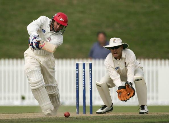 HAMILTON, NEW ZEALAND - MARCH 25:  Chris Harris of Canterbury plays a shot in front of Peter McGlashan of the Northern Knights during day four of the State Championship Final between the Northern Knights and the Canterbury Wizards at Seddon Park on March 25, 2007 in Hamilton, New Zealand.  (Photo by Phil Walter/Getty Images)