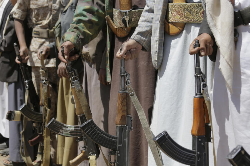 Shiite Houthi tribesmen hold their weapons during a tribal gathering showing support for the Houthi movement, in Sanaa, Yemen, Saturday Sept. 21, 2019. Yemen's Houthi rebels said late Friday night that they were halting drone and missile attacks against Saudi Arabia, one week after they claimed responsibility for a strike that crippled a key oil facility in the kingdom. (AP Photo/Hani Mohammed)