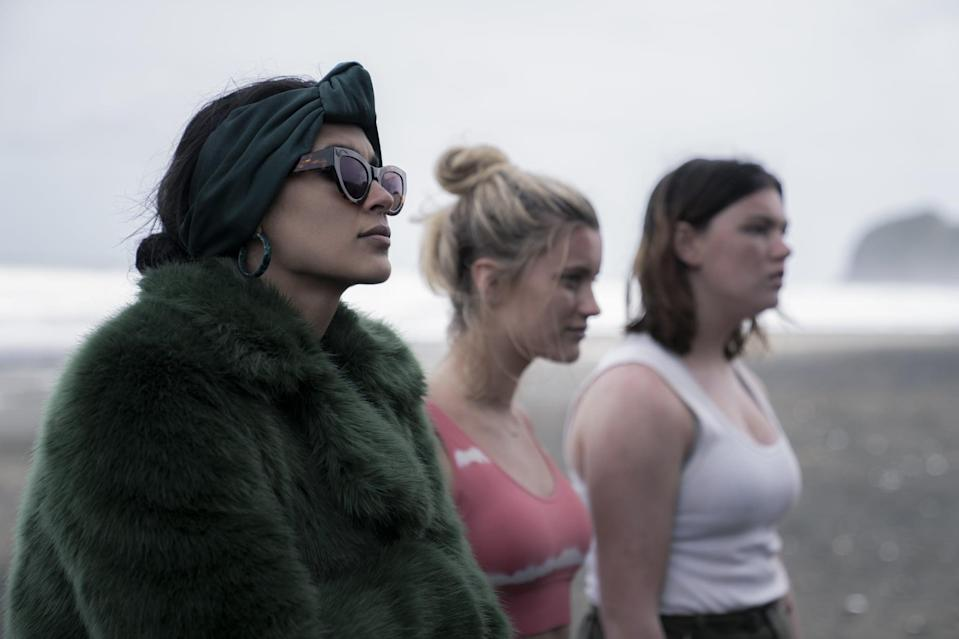 <p>Fatin looks like the <em>opposite</em> of someone who's been stuck on an island in this green fur jacket, and we love her for it. She ups the luxe factor with a matching headband, resin hoops, and cat-eye sunglasses. It's a one-of-a-kind gem Joshua found in a costume stock in Los Angeles, and you can shop a few similarly chic jackets ahead.</p>