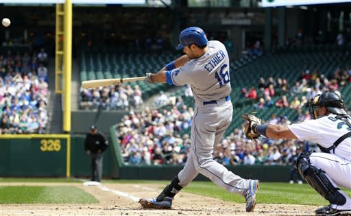 Los Angeles Dodgers' Andre Ethier hits a grand slam against the Seattle Mariners in the second inning of a baseball game on Sunday, June 10, 2012, in Seattle. (AP Photo/Elaine Thompson)