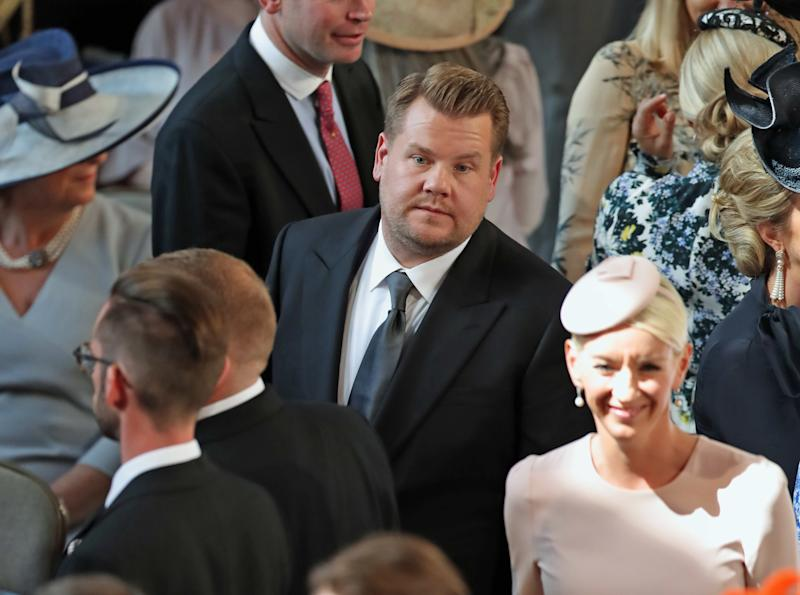 Corden inside St. George's Chapel at Windsor Castle in one of the photos where he sort of looks miserable.