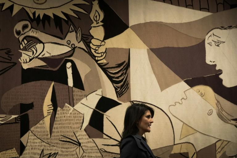 """Then-US ambassador to the United Nations Nikki Haley walks past a replica of """"Guernica"""" by Pablo Picasso at the UN headquarters in January 2018"""